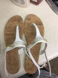 Pair of brown-and-white sandal size 9 Toronto
