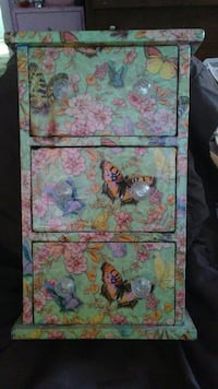 green, brown, and pink floral nightstand