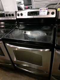GE glass top electric stove working perfectly 4 months warranty