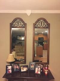 Two rectangular brown wooden framed wall mirrors