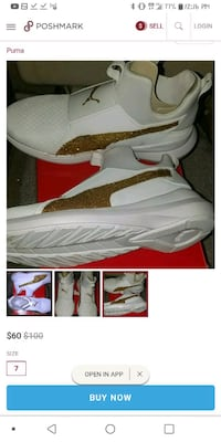 Gold and white PUMA running shoes