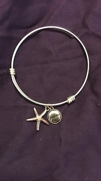 silver bracelet with star fish pendant