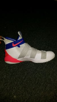 unpaired white and red Nike basketball shoe Baton Rouge, 70805