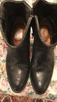 pair of black Frye round-toe cowboy boots