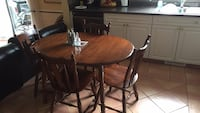 round brown wooden table with four chairs dining set Surrey, V3W 8P7