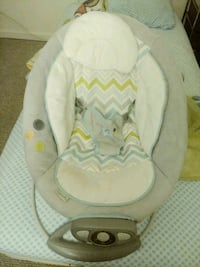 baby's white and pink bouncer Frederick