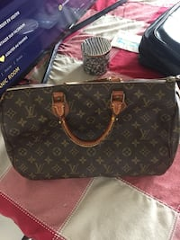black and brown Louis Vuitton leather tote bag Laval, H7G