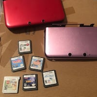Red nintendo ds with game cartridges Ventura, 93003