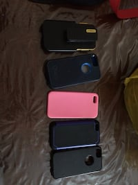Five assorted iphone cases