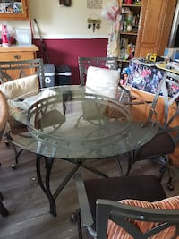 Glass table with 4 chairs null