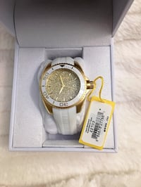 round gold-colored analog watch with box 2267 mi