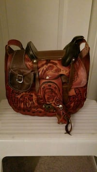 brown leather saddle handbag Airdrie, T4A 0T3