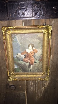 Gold framed picture of boy