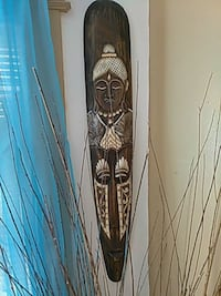 brown and white wooden tribal mask wall decor