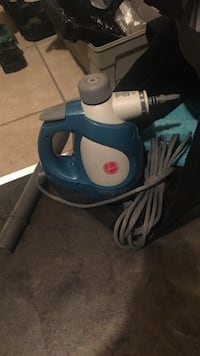 blue and white Hoover steam vacuum