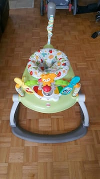 toddler's green, back, and white Fisher-Price plas