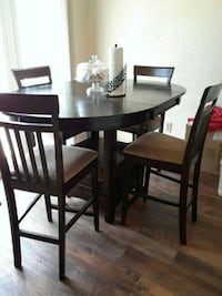 round brown wooden table with four chairs dining set Manteca, 95337