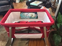 Brand new red bassinet  Alexandria, 22308