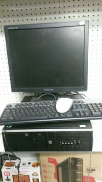 black Samsung flat screen computer monitor, corded keyboard, tower, and white corded mouse Elyria, 44035