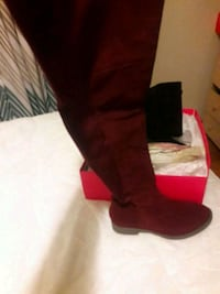 unpaired red high heeled boot with box 210 mi