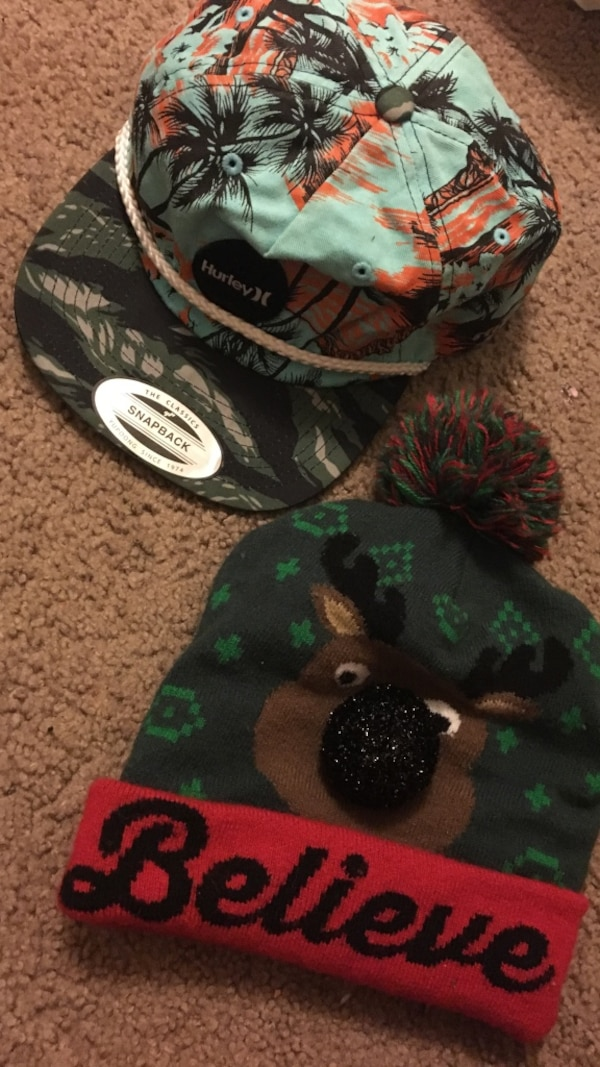 94790c810c3 Used Teal-and-woodland camouflage snapback cap  black-and-red believe print  bobble hat for sale in Olympia - letgo