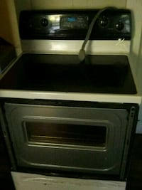 white and black electric top stove (220Line) Cleveland, 44127