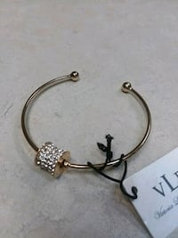 New Gold bangle bracket, $1.00