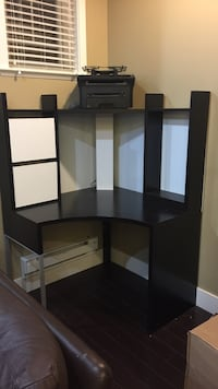 Black wooden desk with hutch