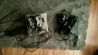 black Xbox 360 console with controller and game cases Indianapolis, 46201