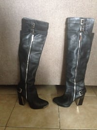 pair of black leather knee high boots Price, 84501