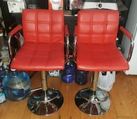 2 red leather adjustment counter height chairs  Columbia, 21045