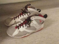 pair of white-and-red Nike basketball shoes Vancouver, V6A 1G4