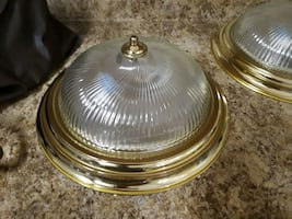 round brass-colored dome light