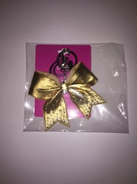 Gold ribbon keychain with pack