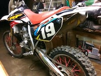 red and white motocross dirt bike Max Meadows, 24360