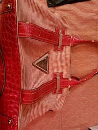 gold-colored and red leather wristlet Selkirk, R1A 0X1