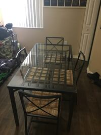 Glass kitchen table with four chairs 856 mi