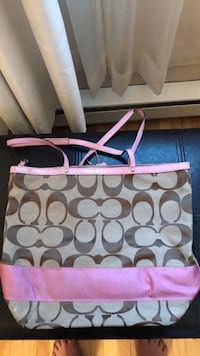 White and pink coach monogram tote bag