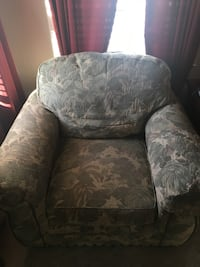 brown and gray floral fabric sofa chair 1 km