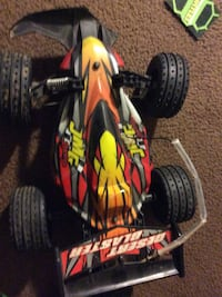 red, yellow, and black RC racing car
