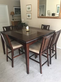 """High Top Square table and six chairs 54"""" x 54"""" chairs upholstered with tan fabric. Good condition. Stone center of table. Thousand Oaks, 91362"""