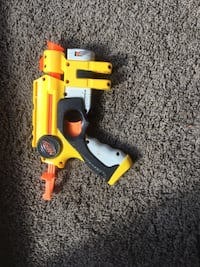 yellow and orange Nerf airsoft gun