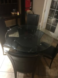 round glass top table with four chairs dining set Glendale, 85303