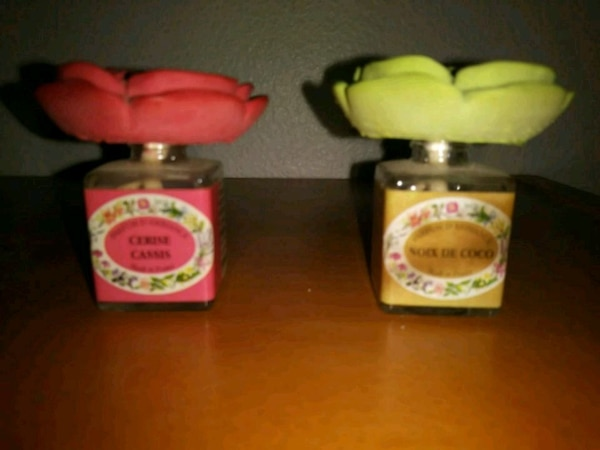 Set of 2 small floral decorative bottles