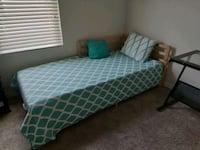 teal and white mattress and brown wooden bed frame Fort Myers, 33901