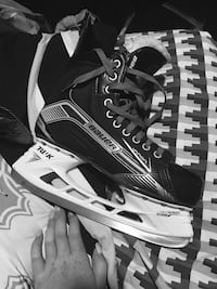 black-and-gray Bauer ice skates