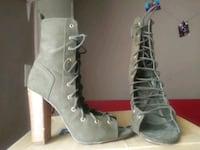 pair of gray leather high heeled boots Tampa, 33612