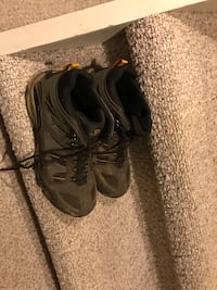 pair of black Nike running shoes null