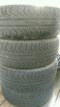 Pirelli P4 205/55/16 tires and 5x100 mags in good  Châteauguay, J6K
