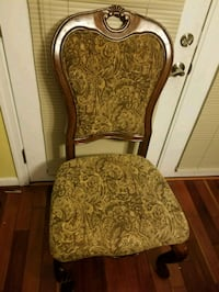 brown wooden frame brown padded armchair